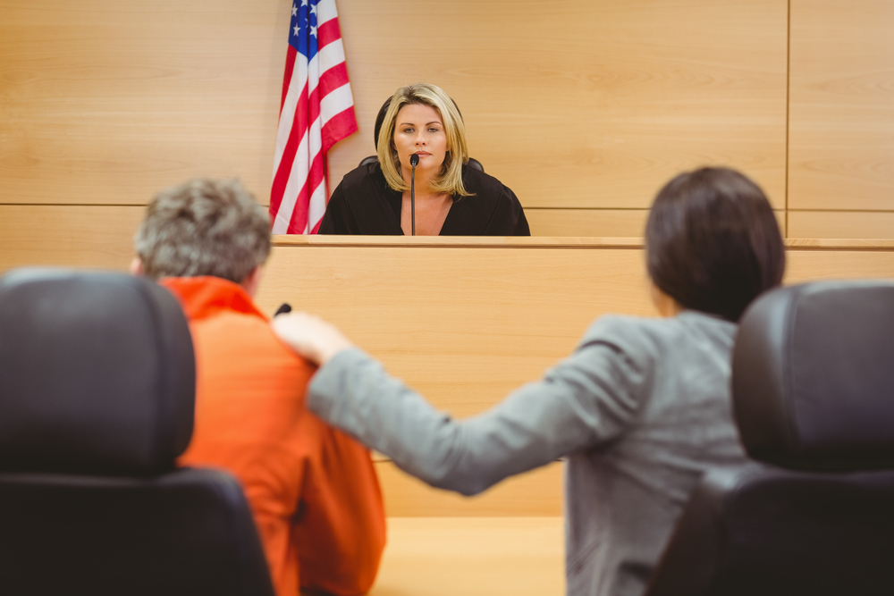 judge ,attorney and the prisoner in the court hearing